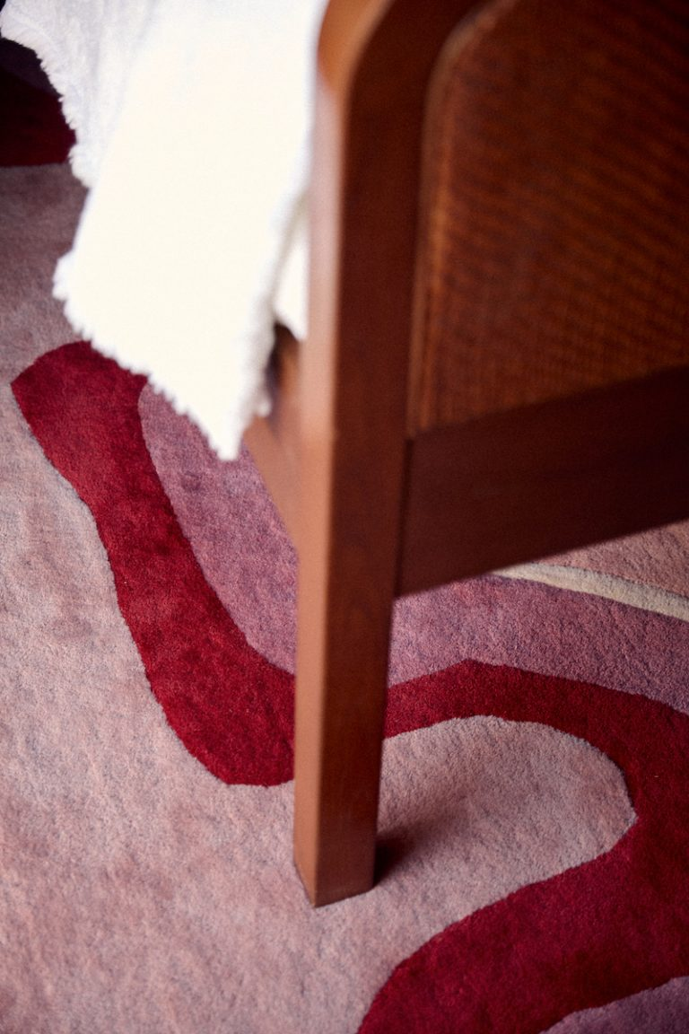 Closeup of bed leg on carpeted floor